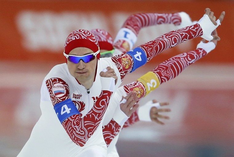 Russia's Denis Yuskov leads teammates Aleksey Yesin and Aleksandr Rumyantsev during the men's speed skating team pursuit finals event at the Adler Arena in the Sochi 2014 Winter Olympic Games February 22, 2014. (REUTERS/Phil Noble)