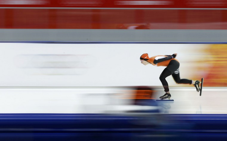 Irene Wust of the Netherlands skates to a first place finish during the women's 3,000-meter speed skating race at the Adler Arena during the 2014 Sochi Winter Olympics, February 9, 2014. (Phil Noble/Reuters)