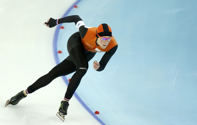 Jorien ter Mors of the Netherlands skates to a first-place finish in the women's 1,500-meter speedskating race at the Adler Arena during the 2014 Sochi Winter Olympics, February 16, 2014. (Issei Kato/Reuters)