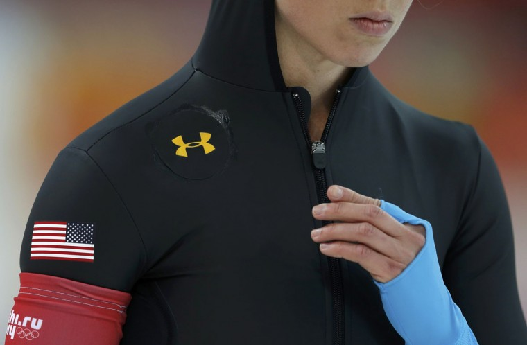 Jilleanne Rookard of the U.S. waits to compete in the women's 1,500-meter speedskating race at the Adler Arena during the 2014 Sochi Winter Olympics, February 16, 2014. U.S. speed-skaters decided on Friday to drop new, specially designed Under Armour suits that media reports have linked to a dismal showing at the Sochi Games, reverting to apparel worn during recent World Cup events. (Phil Noble/Reuters)