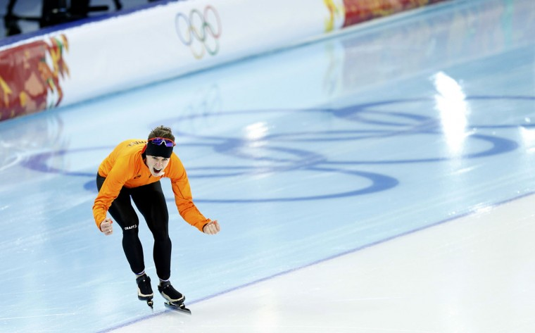 Irene Wust of the Netherlands celebrates after realising she has won the women's 3000-meters speed skating event during the 2014 Sochi Winter Olympics, February 9, 2014. (Issei Kato/Reuters)