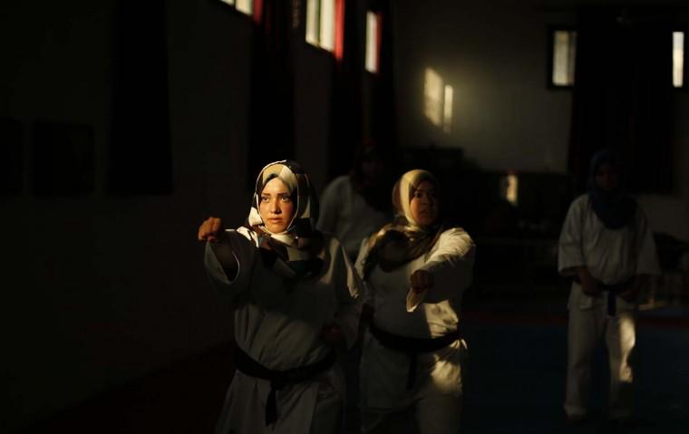 Palestinian girls take part in a karate class at al-Reyadi club in Gaza City February 24, 2014. (Reuters/Suhaib Salem)