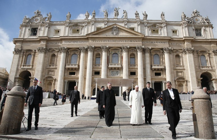 Pope Francis walks as he leads the general audience in Saint Peter's Square at the Vatican February 12, 2014. (REUTERS/Tony Gentile)