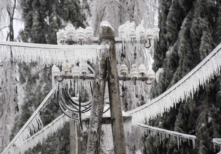 Ice-covered electric power pillar is seen in Postojna February 3, 2014. A quarter of households in Slovenia were left without electricity on Monday after a weekend of blizzards and very low temperatures wreaked havoc on power lines and roads, the national STA news agency reported. (Srdjan Zivulovic/Reuters)