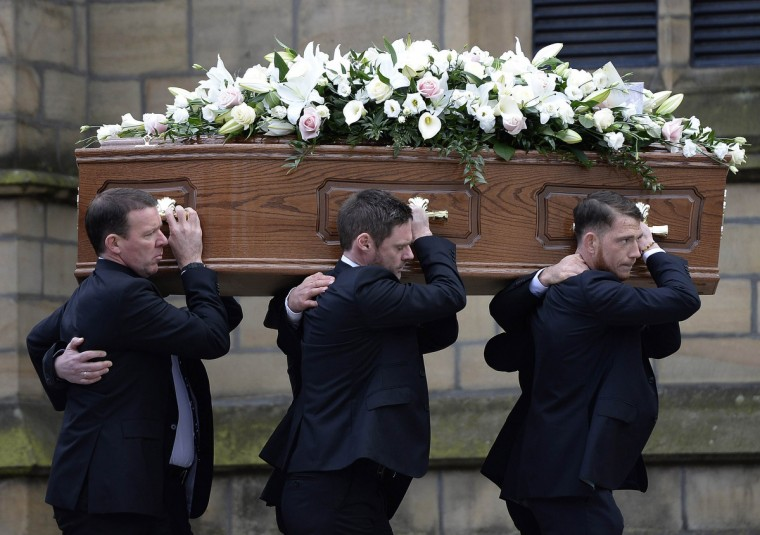 The coffin of former Preston and England soccer player Tom Finney arrives for his funeral at Preston Minster, northern England February 27, 2014. Finney, who played in three World Cups and scored a total of 30 goals in 76 international appearances, died on February 14 at the age of 91. (Nigel Roddis//Reuters)
