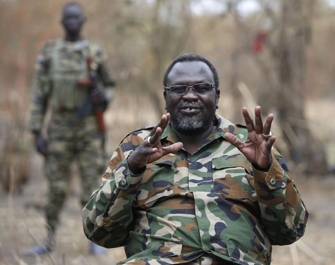 South Sudan's rebel leader Riek Machar gestures as he speaks to rebel General Peter Gatdet Yaka (not seen) in a rebel controlled territory in Jonglei State February 1, 2014. REUTERS/Goran Tomasevic
