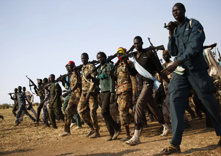 Jikany Nuer White Army fighters, a local youth militia affiliated with the rebels, walk in Upper Nile State February 12, 2014. South Sudanese rebels withdrew on Tuesday a threat to boycott peace talks with the government, saying mediators had promised to address their list of demands. (REUTERS/Goran Tomasevic)