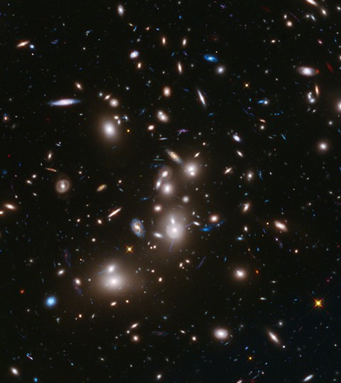 A long-exposure Hubble Space Telescope image of the galaxy cluster Abell 2744, the deepest ever made image of any cluster of galaxies, is seen in an undated NASA handout. It shows some of the faintest and youngest galaxies ever detected in space. Abell 2744, located in the constellation Sculptor, appears in the foreground of this image. It contains several hundred galaxies as they looked 3.5 billion years ago. (NASA/ESA/Handout via Reuters)