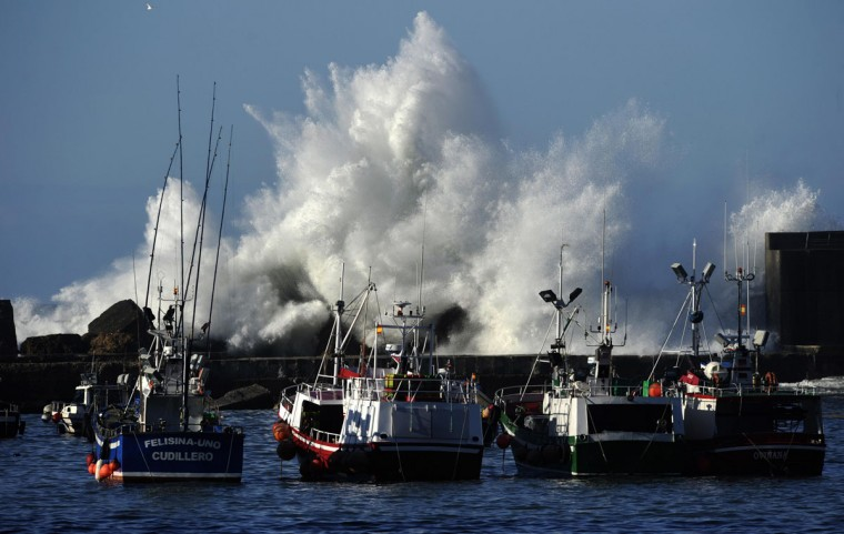 Waves crash onto a breakwater, partially destroyed during Saturday night's storm, in Cudillero, Spain, February 2, 2014. Rough weather brought the north of Spain to a standstill with 26-foot high waves causing damage in many coastal towns. (Eloy Alonso/Reuters)