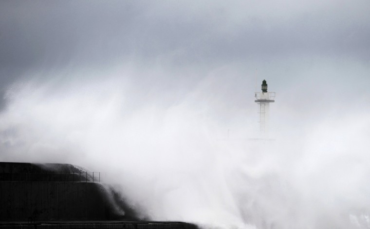Huge waves crash onto San Esteban de Pravia seafront in the northern Spanish region of Asturias, February 28, 2014. (REUTERS/Eloy Alonso)