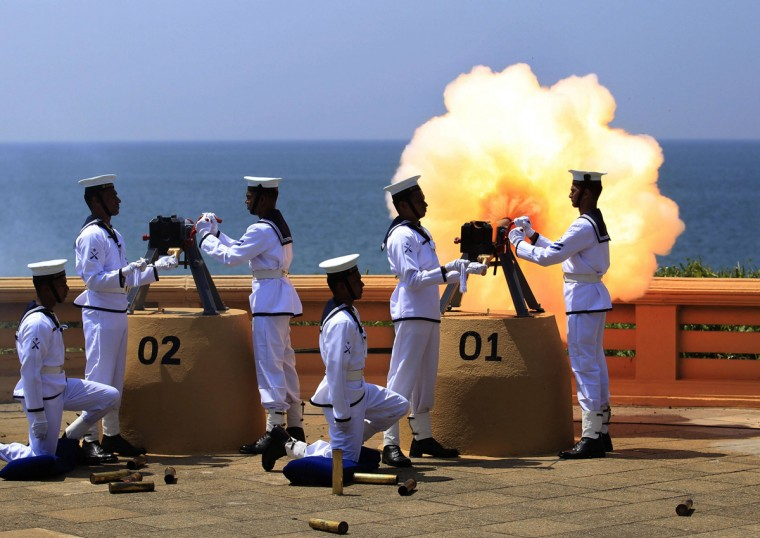 Sri Lanka's navy fires a gun salute as a part of main celebrations for Sri Lanka's 66th Independence Day in Colombo February 4, 2014. Sri Lanka obtained independence from British rule in 1948. (Dinuka Liyanawatte/Reuters)