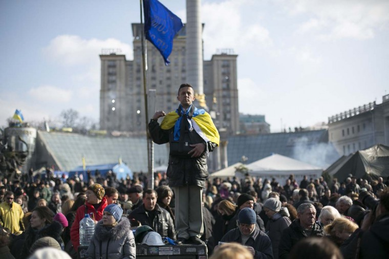 A man attends a prayer at Kiev's Independence Square February 24, 2014. (Reuters/Baz Ratner)