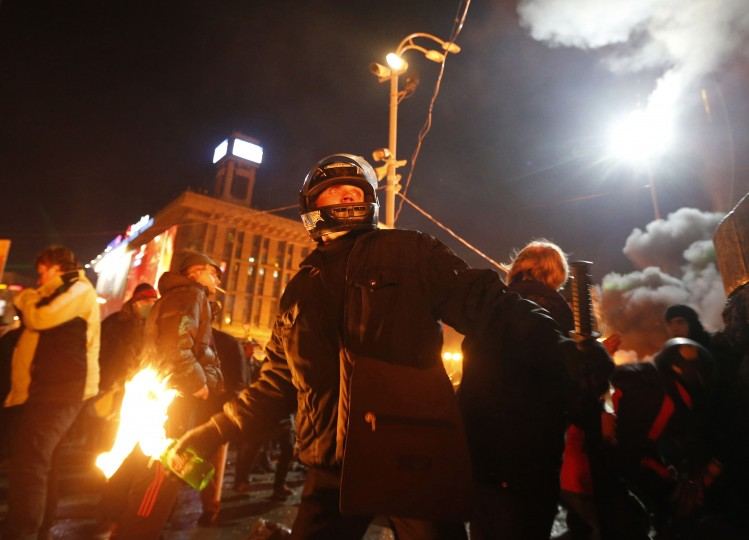 An anti-government protester prepares to throw a petrol bomb during clashes with riot police at Independence Square in Kiev February 18, 2014. Ukrainian riot police advanced on Tuesday onto a central Kiev square occupied by protesters, after at least 14 people died in the worst day of violence since demonstrations erupted against President Viktor Yanukovich 12 weeks ago. (REUTERS/Vasily Fedosenko)