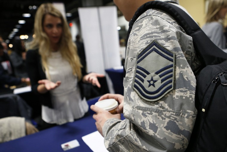 A staffer talks with a member of the U.S. Air Force at a job fair in January.  A job fair for Veterans is planned for Wednesday at the Virginia Beach Convention Center.  || Credit: Kevin Lamarque   - Reuters
