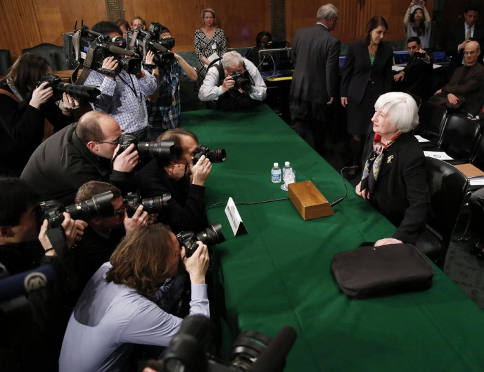 U.S. Federal Reserve Board Chair Janet Yellen (R) is photographed before testifying at the Senate Banking Housing and Urban Affairs Committee on Capitol Hill in Washington. (Gary Cameron/Reuters)