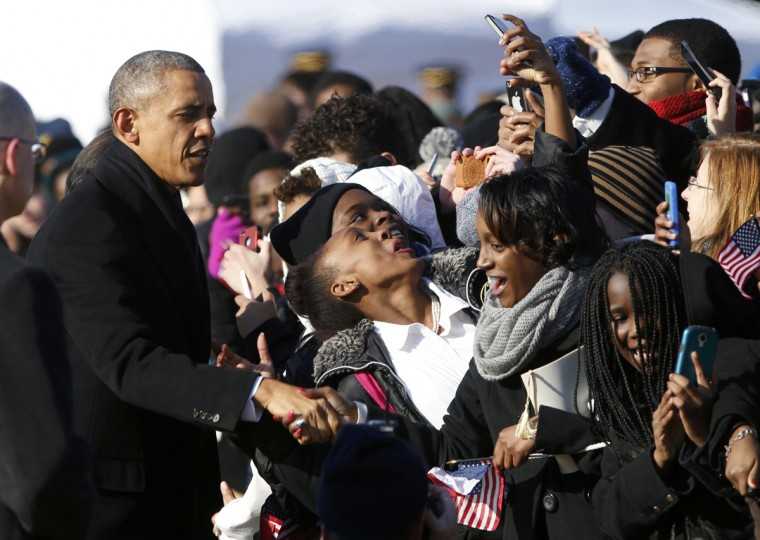 A woman takes a self portrait with U.S. President Barack Obama (L) as Obama and French President Francois Hollande greet students at a State Arrival ceremony in Hollande's honor on the South Lawn of the White House in Washington, February 11, 2014. (Jonathan Ernst/Reuters)