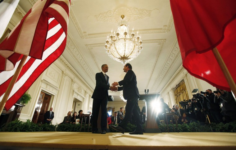 U.S. President Barack Obama (L) greets French President Francois Hollande following a joint news conference in the East Room of the White House in Washington, February 11, 2014. (Larry Downing/Reuters)
