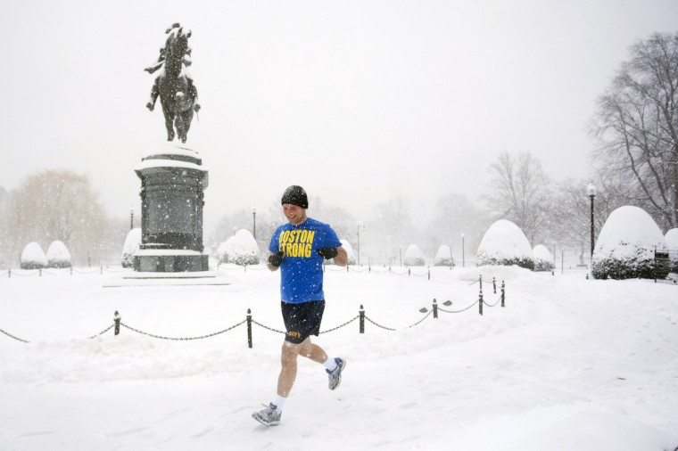Dan Hazelwood goes for a run in the Public Garden during a winter storm in Boston, Massachusetts. Cities and towns in the Northeast declared a snow emergency in expectation of accumulations of a foot or more. (Dominick Reuter/Reuters)