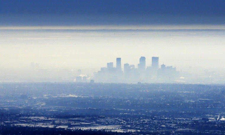 A band of fog envelops downtown Denver early February 26, 2014. (REUTERS/Rick Wilking)