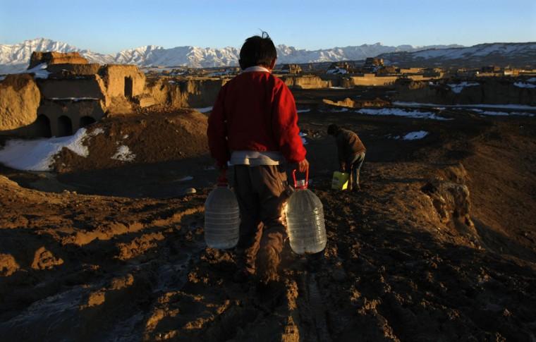 An Afghan boy carries water in Kabul on Feb. 17, 2008. (REUTERS/Ahmad Masood)