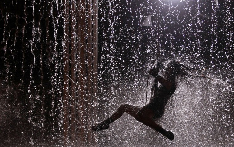 An artist performs during the Waterwall show in Lisbon on Aug. 5, 2011. Waterwall, a Italian production based on water, tumblers and music, is held as part of Lisbon's summer festivities. (REUTERS/Jose Manuel Ribeiro)