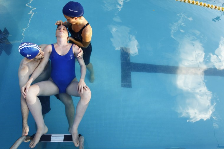 Katy and her husband Facundo practice her breathing during a swimming pool prenatal course run by the private Aquamater clinic in Caracas on Oct. 1, 2011. (REUTERS/Jorge Silva)