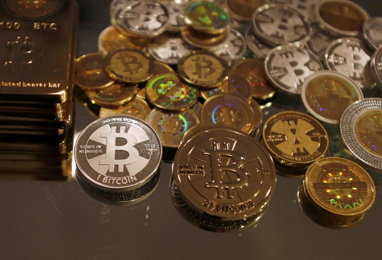 Bitcoins created by enthusiast Mike Caldwell are seen in a photo illustration at his office in Sandy, Utah. (REUTERS/Jim Urquhart)