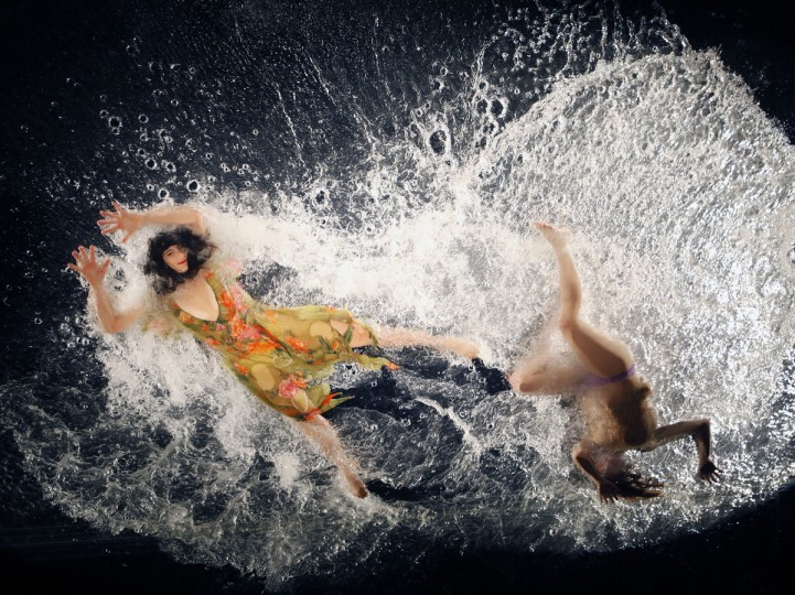 Dancers perform on a transparent overhead water stage during a media preview and dress rehearsal for the Fuerzabruta (Brute Force) show in Taipei, Taiwan on Dec. 14, 2009. (REUTERS/Nicky Loh)