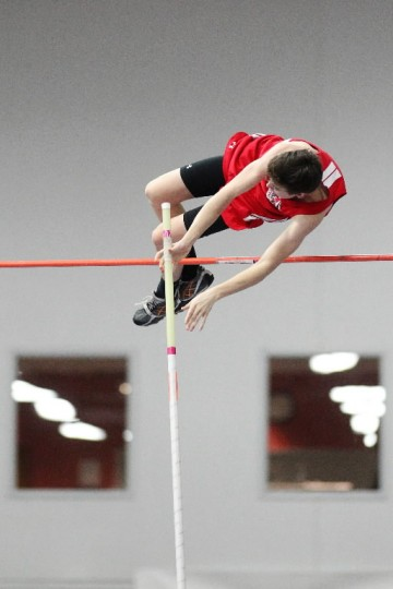 Glenelg's Calvin Pitney pole vaults during the indoor track and field championships at Prince George's Sports and Learning Complex in Landover Tuesday, Feb. 18. (Jen Rynda/BSMG)
