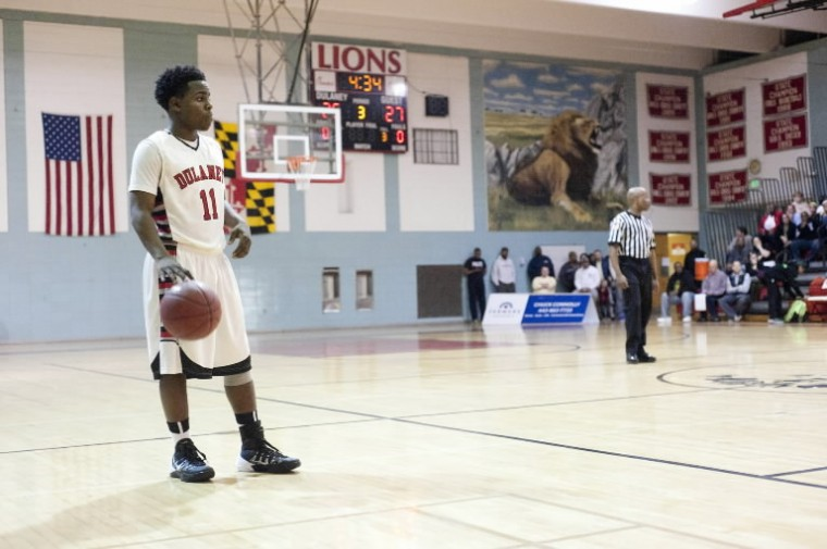 Dulaney's Jason Lawson dribbled the ball for more than three minutes in the third quarter of their game against Milford Mill on Wednesday, Feb. 19. (Noah Scialom/BSMG)