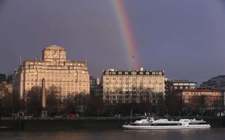 A rainbow is seen over the Savoy Hotel and the Shell Shipping and Trading Company in London Jan. 31, 2014. (Suzanne Plunkett/Reuters)