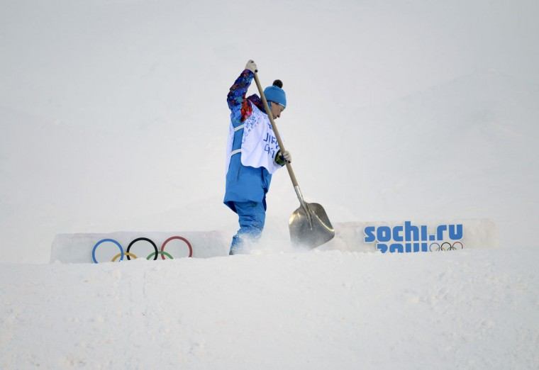 A crew member prepares the course for ladies moguls qualification in Sochi 2014 Olympic Winter Games at Rosa Khutor Extreme Park. (Jack Gruber-USA TODAY Sports)