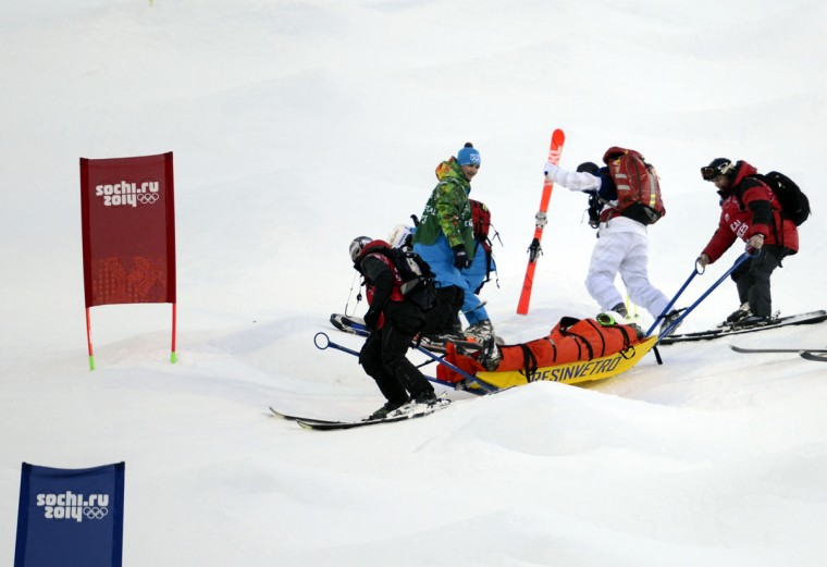 Heidi Kloser (USA) is taken down the mountain after falling during warmups prior to ladies moguls qualification in Sochi 2014 Olympic Winter Games at Rosa Khutor Extreme Park. (Jack Gruber-USA TODAY Sports)