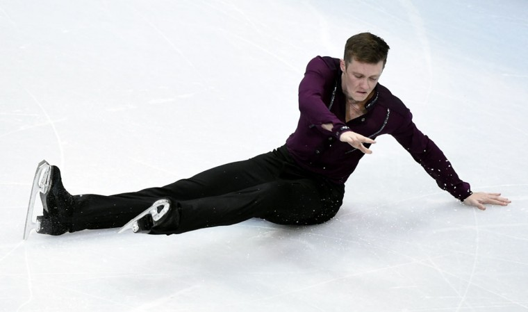 Jeremy Abbott (USA) falls during the figure skating team men's short program in the Sochi 2014 Olympic Winter Games at Iceberg Skating Palace. (Richard Mackson-USA TODAY Sports)