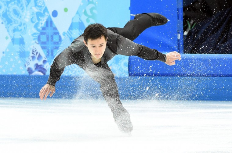 Canada's Patrick Chan performs during the figure skating team men's short program in the Sochi 2014 Olympic Winter Games at Iceberg Skating Palace. (Robert Deutsch-USA TODAY Sports)