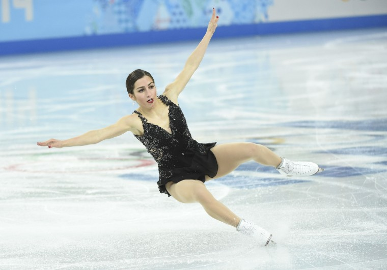 Americans Marissa Castelli falls during the figure skating team pairs free skating portion of the competition at the Sochi 2014 Olympic Winter Games at Iceberg Skating Palace. (Robert Deutsch-USA TODAY Sports)