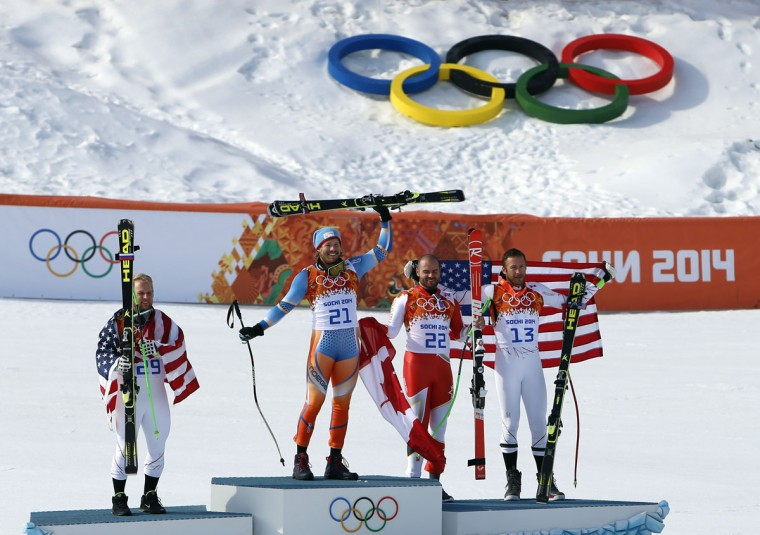 Kjetil Jansrud of Norway wins gold, Team USA's Andrew Weibrecht wins silver, and Jan Hudec of Canada and Bode Miller of the U.S. tie for bronze in the men's alpine skiing super-G during the Sochi 2014 Olympic Winter Games at Rosa Khutor Alpine Center. (Nathan Bilow/USA TODAY Sports)