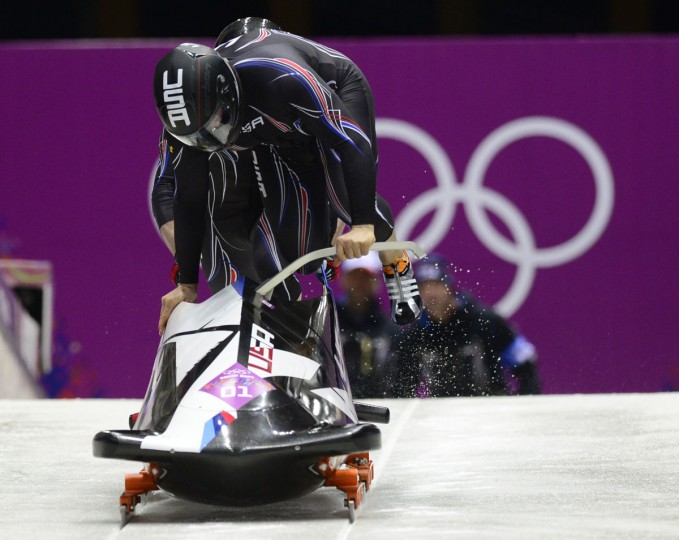 The United States team piloted by Steven Holcomb with Steven Langton competes in the final heat of two-man bobsled race during the Sochi 2014 Olympic Winter Games at Sanki Sliding Center. (John David Mercer/USA TODAY Sports)