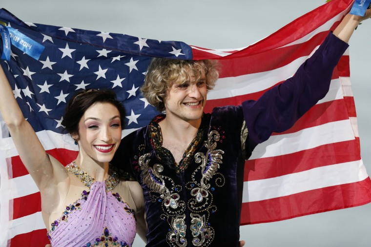 Charlie White and Meryl Davis celebrate winning the United States' first-ever gold medal in ice dancing during the Sochi 2014 Olympic Winter Games at Iceberg Skating Palace. (Jeff Swinger/USA TODAY Sports)