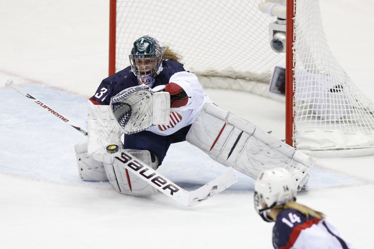 USA goalkeeper Jessie Vetter (31) makes a save in the women's ice hockey gold medal game against Canada during the Sochi 2014 Olympic Winter Games at Bolshoy Ice Dome. (Winslow Townson-USA TODAY Sports)