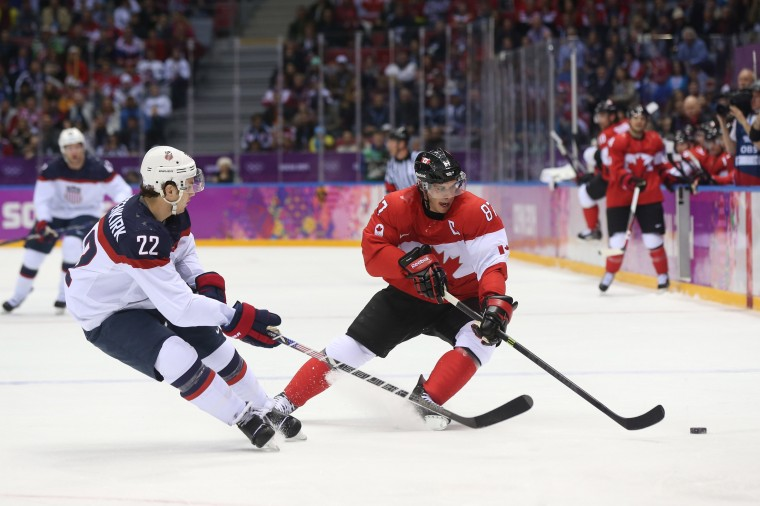 Canada forward Sidney Crosby (87) and USA defenseman Kevin Shattenkirk (22) battle for the puck in the men's ice hockey semifinals during the Sochi 2014 Olympic Winter Games at Bolshoy Ice Dome. (Winslow Townson-USA TODAY Sports)