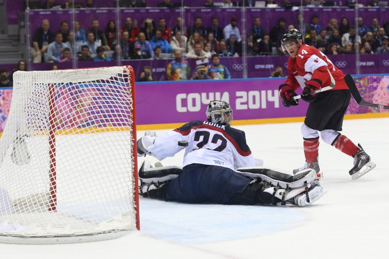 Canada forward Chris Kunitz (14) takes a shot against USA goalie Jonathan Quick (32) in the men's ice hockey semifinals during the Sochi 2014 Olympic Winter Games at Bolshoy Ice Dome. (Winslow Townson-USA TODAY Sports)