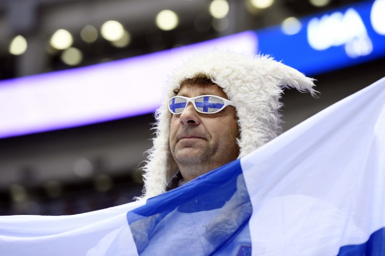 A fan of Finland waves a flag in the men's ice hockey bronze medal game against USA during the Sochi 2014 Olympic Winter Games at Bolshoy Ice Dome. (Scott Rovak-USA TODAY Sports)