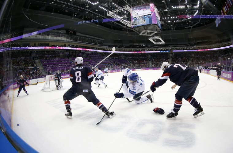 USA defenseman Kevin Shattenkirk (22) loses a glove as forward Joe Pavelski (8) defends against Finland forward Tuomo Ruutu (15) in the men's ice hockey bronze medal game during the Sochi 2014 Olympic Winter Games at Bolshoy Ice Dome. (Winslow Townson-USA TODAY Sports)