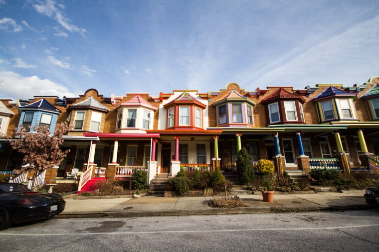 "Abell is known its vibrantly-colored ""Painted Lady"" rowhouses throughout the neighborhood painted in funky, bright colors for an annual Charles Village contest. (Kalani Gordon/Baltimore Sun/2014)"