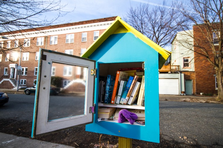 One of the Abell open spaces along 32nd Street in Abell includes several toys for children, a community bulletin board and a Little Free Library box. (Kalani Gordon/Baltimore Sun/2014)