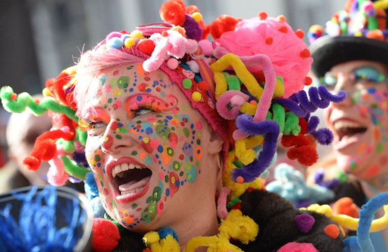 Women dressed in carnival costumes celebrate the street carnival in Duesseldorf, western Germany on February 27, 2014. Germans, mainly in the western Rhine region, crowd the streets to celebrate Carnival. (Patrik Stollarz/Getty Images)
