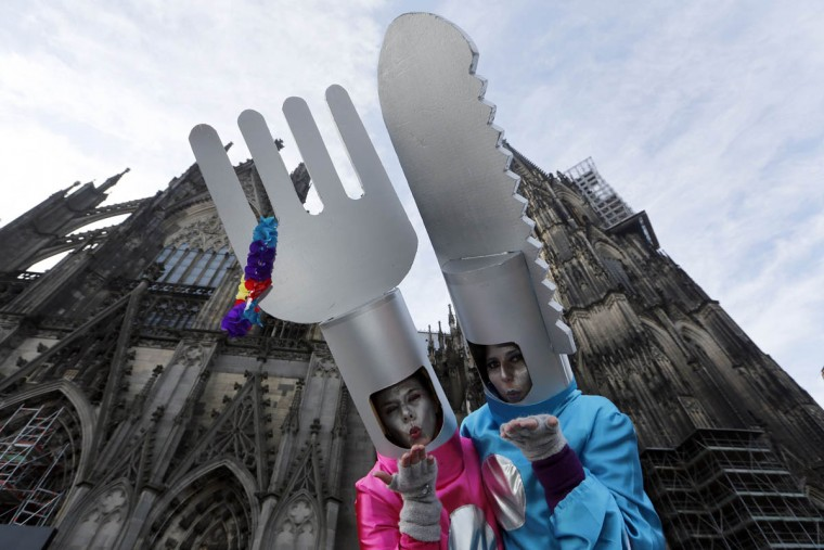 """Women dressed in costumes for """"Weiberfastnacht"""" (Women's Carnival) celebrate in front of Cologne's Cathedral February 27, 2014. Women's Carnival marks the start of a week of street festivals, the highlight of the event being """"Rosenmontag"""" (Rose Monday), the final day of the carnival where mass processions are held. (Ina Fassbender/Reuters photo)"""