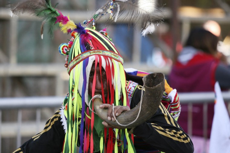 A Bolivian indigenous man participates in the Anata Andina (Andean carnival) in Oruro February 27, 2014. Hundreds of ethnic groups from Oruro province participated in the carnival. (Gaston Brito/Reuters photo)