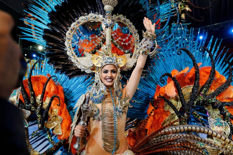 Amanda Perdomo celebrates after being elected Queen of the 2013 Santa Cruz carnival on February 26, 2014 in Santa Cruz de Tenerife on the Canary island of Tenerife, Spain. The Carnival of Santa Cruz de Tenerife brings every year thousands of revellers. Santa Cruz is the closest European equivalent to the Brazilian Carnival from Rio Janeiro. (Pablo Blazquez Dominguez/Getty Images)